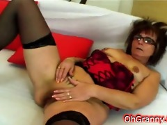 nerdy granny sucking on huge dong